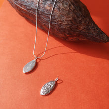 Load image into Gallery viewer, Sterling silver cacao pod, front and back show to show textured front and CACAO on back