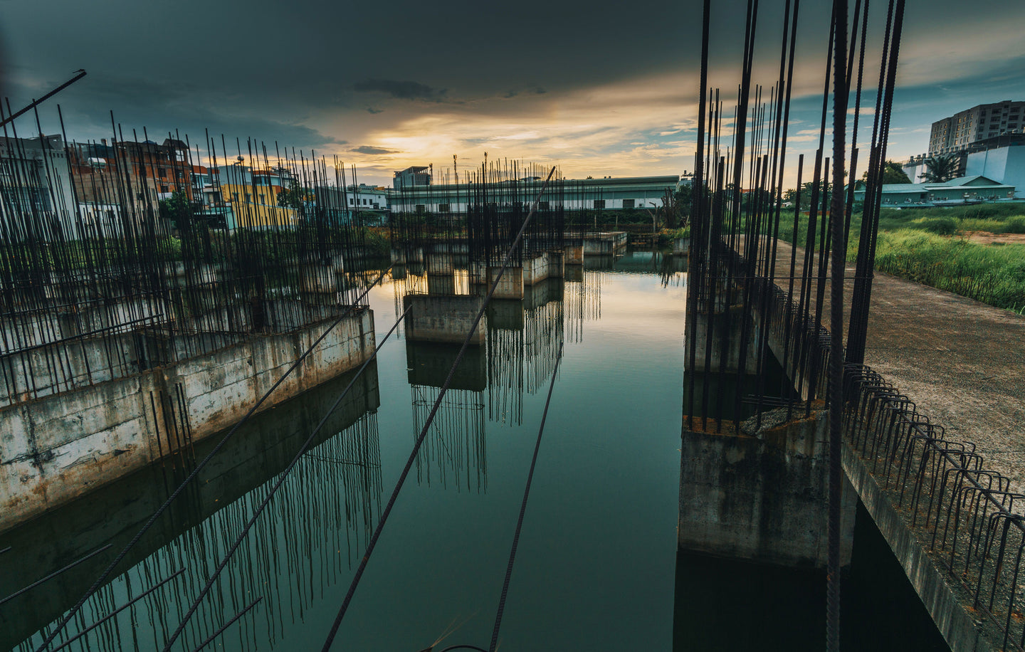 Photo of metal bars on water under dark sky - W-Photographie