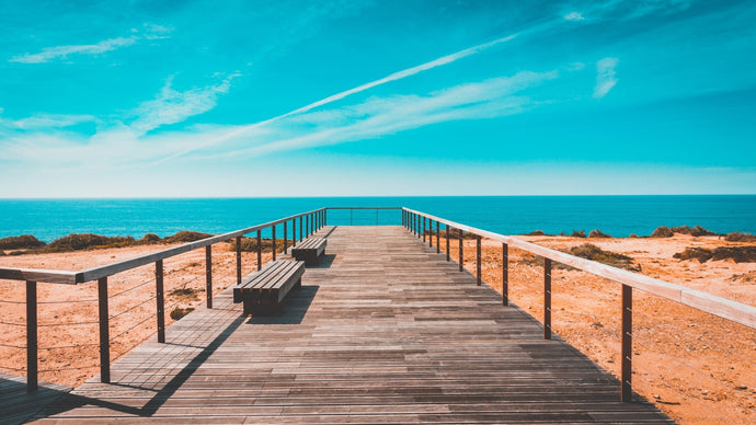Beach bench boardwalk clouds - W-Photographie