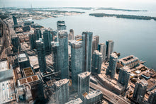 Charger l'image dans la galerie, Aerial photo of buildings near body of water