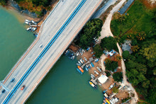 Charger l'image dans la galerie, Aerial photo of vehicule passing through the bridge