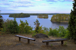 Bench overlooking body of water - W-Photographie