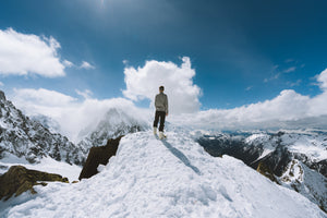 Person standing on slope glacier mountain - W-Photographie