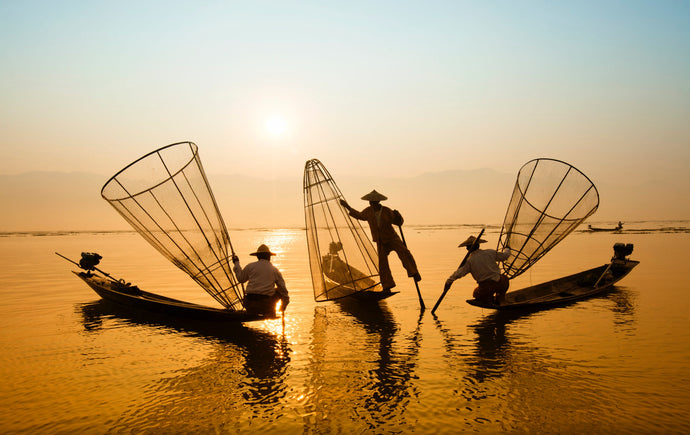 Three men riding boat on body of water - W-Photographie