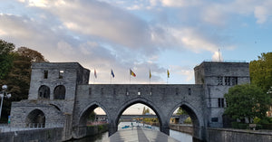 old bridge with flags