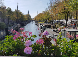 River with boats and flowers
