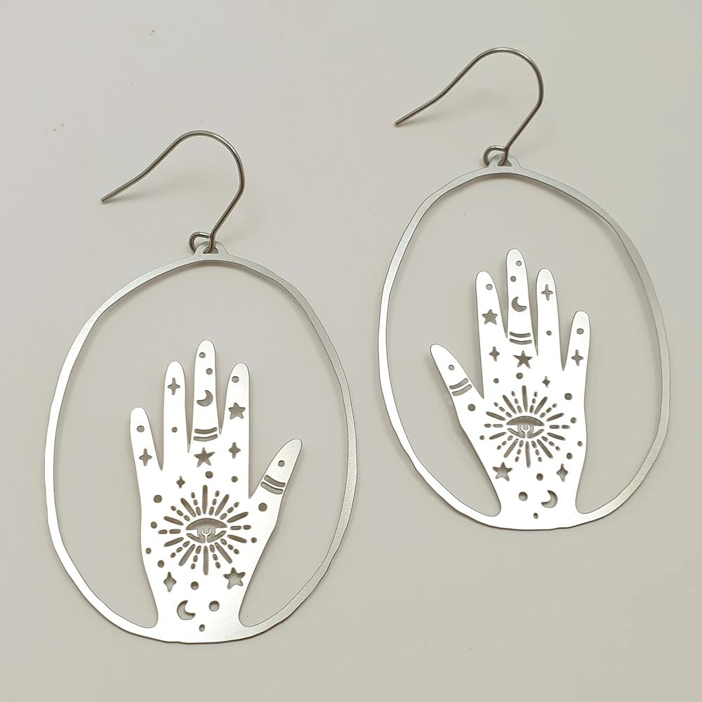 magic hand earrings