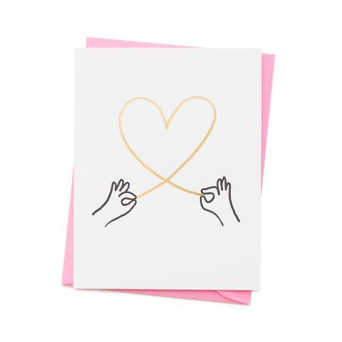 Heart string and hands card