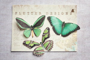 A set off three green silk butterfly hair clips