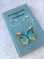Blue silk butterfly necklace on a sterling silver chain