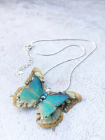 Butterfly necklace on a sterling silver chain with an extender with a star end