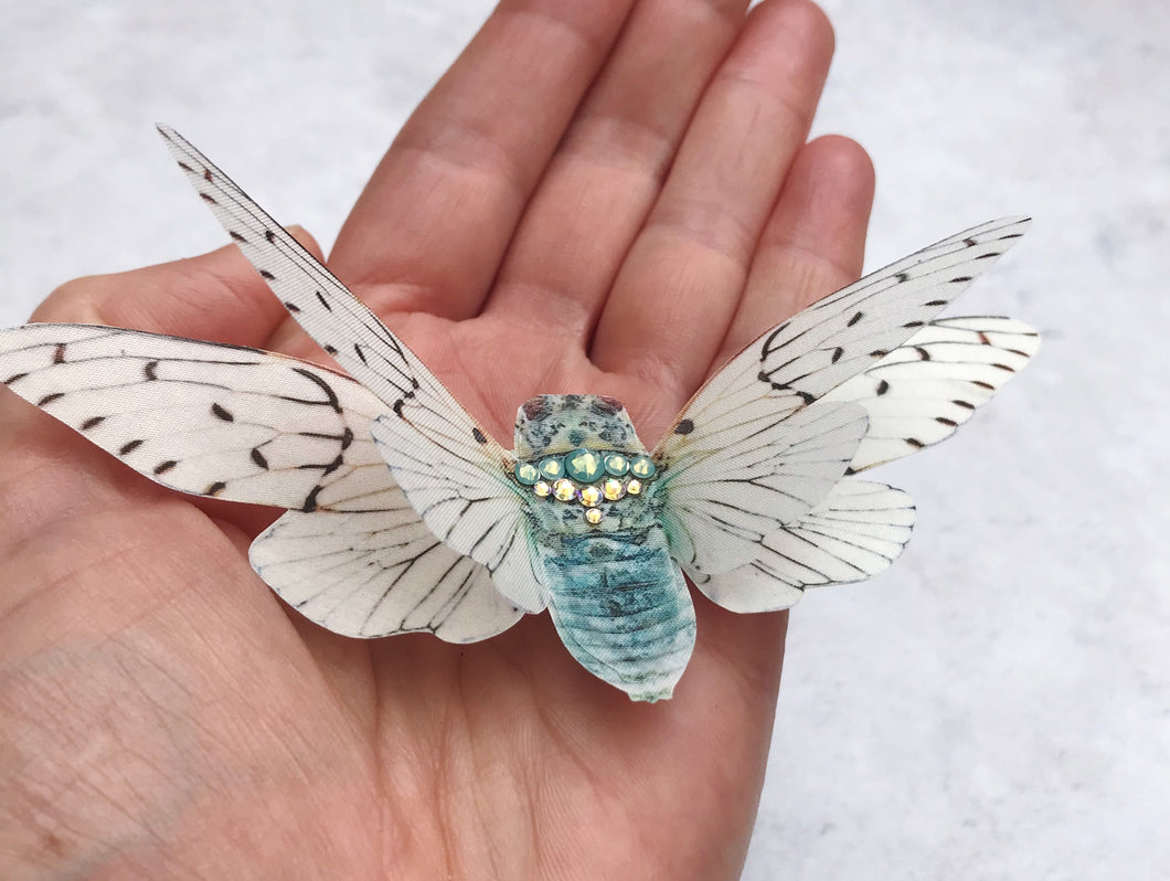 A ghost cicada hair clip with Swarovski crystals
