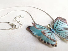 Blue silk butterfly necklace with a pretty silver extender chain with a star