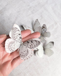 A double layer silk butterfly hair clip with Swarovski Crystals