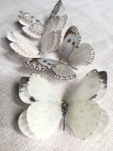 Close up details of silk butterfly hair clips with Swarovski Crystals
