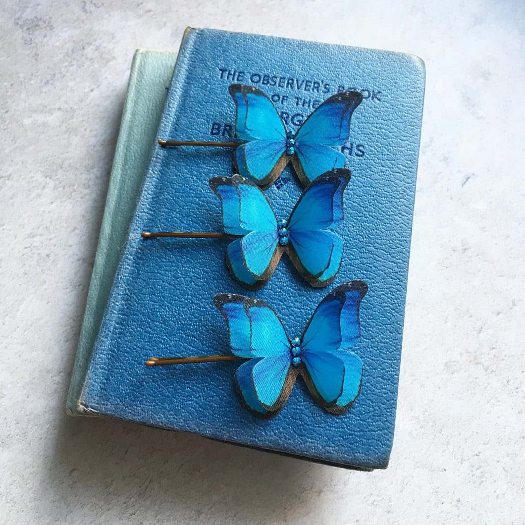 A set of three bright blue Morpho silk butterfly hair pins with Swarovski Crystals