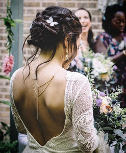 Bride wearing silk butterfly hair accessories by Flutter Designs