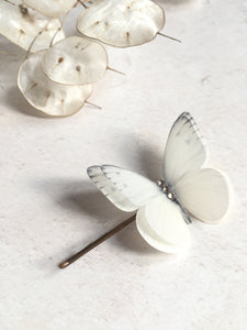 Close up detail of an ivory silk butterfly hair pin by Flutter Designs