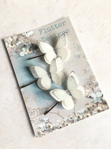 Silk butterfly hair pins packaged on a glossy presentation card