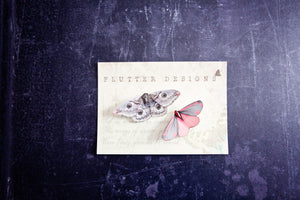 Silk Moth hair clips by Flutter Designs presented on a premium glossy presentation card.