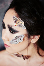 Silk Moth hair clips on the face of a gothic styled model