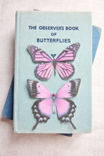Pink Silk butterfly hair clips on a vintage book