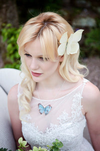 Bride wears a blue silk butterfly necklace