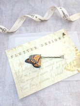 Handmade Monarch butterfly hair pin on a gift presentation card