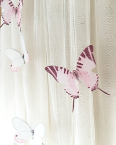 Pink Swallowtail butterfly on a wedding veil