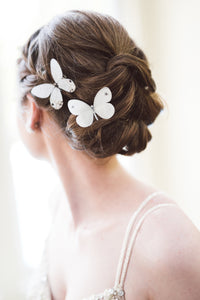 Bride wears silk butterfly hair clips with Swarovski Crystals