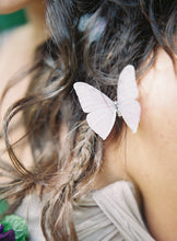 Model wears a lilac butterfly hair clip with crystal detail by Flutter Designs