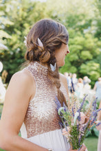 Bride wears silk butterfly hair pins in a braid
