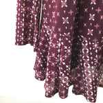 APPAREL,TOPS - TUNIC LENGTH TOP PURPLE COLOR AND PATTERN.  CUTE DETAIL ON THE BACK.