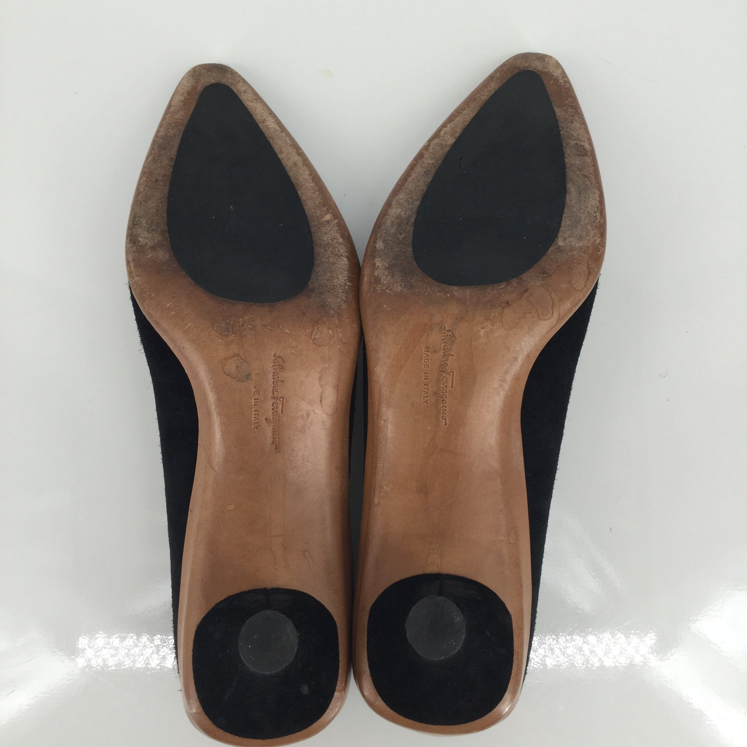 Salvatore Ferragamo Low Heels  - LOW HEELS IN A BLACK SUEDE-LIKE MATERIAL WITH BROWN TRIM ALONG THE SIDES AND HEEL. FEATURES POINTED TOES AND A SILVER BUCKLE ACROSS THE FRONT.