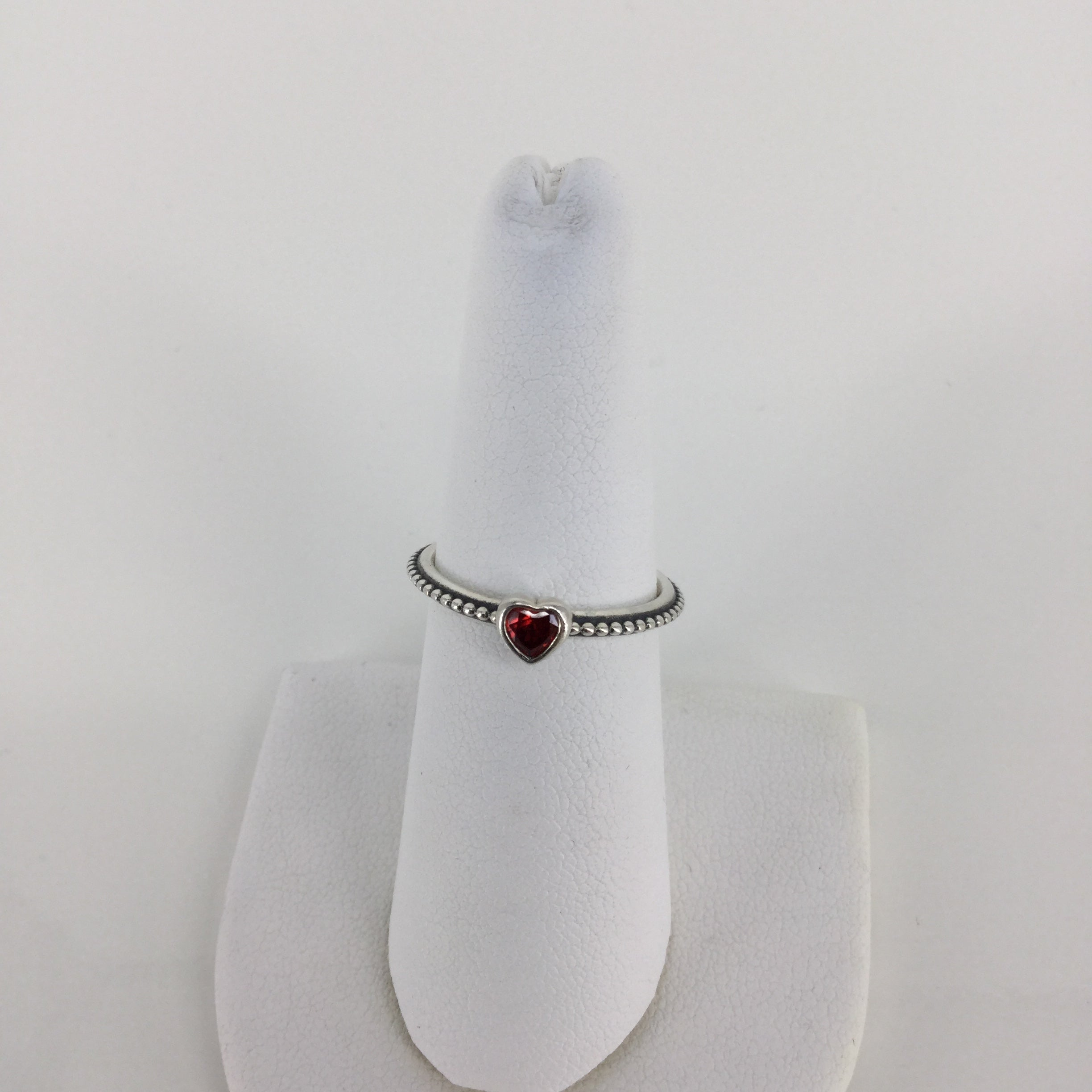 JEWELRY, - LOVELY PANDORA SILVER RING WITH TINY RED HEART GEM. BEADED DETAIL ON THE THIN BAND. PERFECT FOR ANYONE WHO LOVES HEARTS AND SUBTLE JEWELRY!