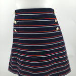Tommy Hilfiger Skirt Size 14 - A NAVY SKIRT FEATURING RED AND WHITE STRIPES, POCKETS, AND GOLD BUTTONS. THERE IS A BACK ZIPPER CLOSURE. APPROXIMATELY 18.5 LONG.