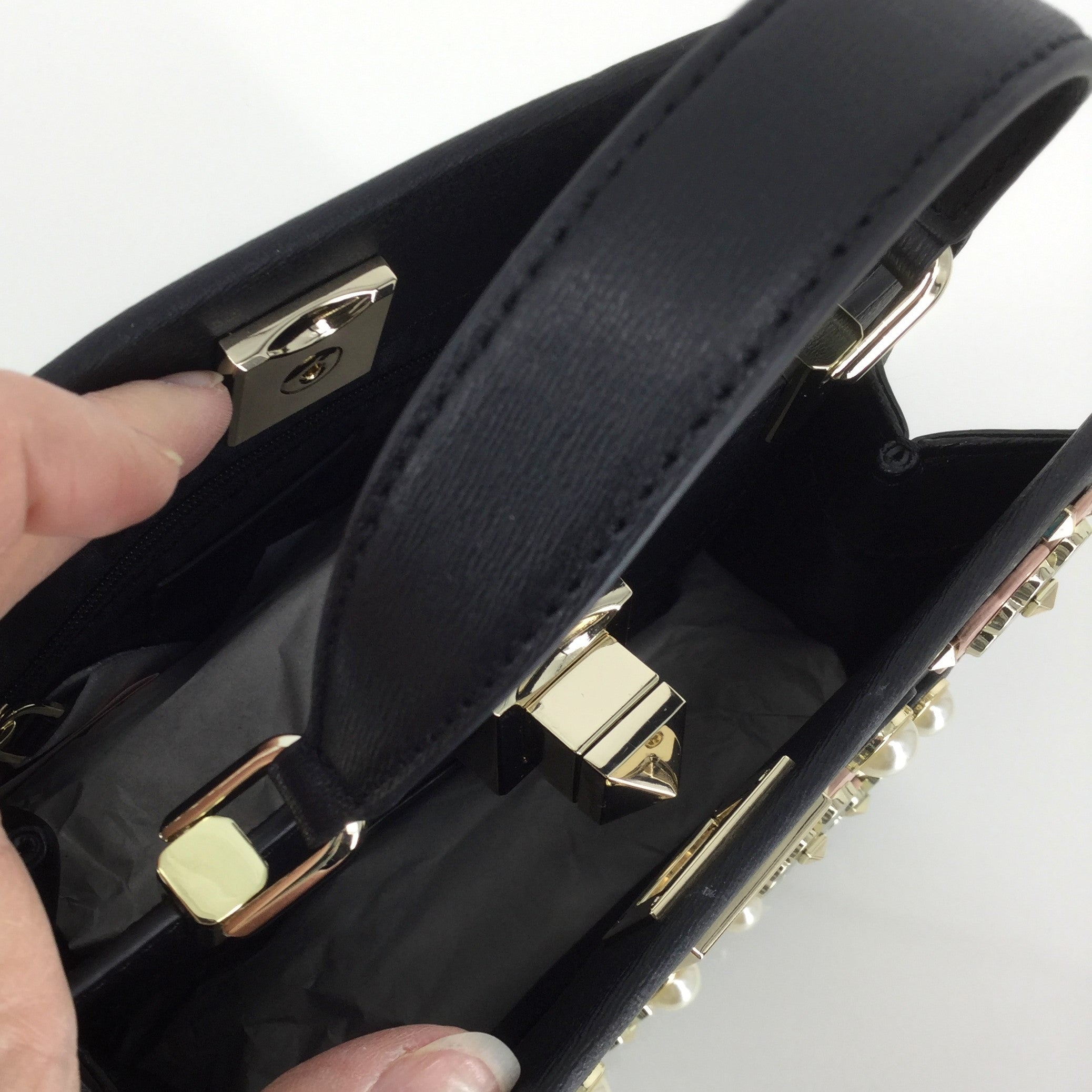 KATE SPADE KELLI DOUBLE COMPARTMENT CROSSBODY - LIKE NEW MINI CROSSBODY BY KATE SPADE NEW YORK. TEXTURED COW LEATHER WITH SILVER HARDWARE. TURNLOCK CLOSURE ON FRONT, SNAP BUTTON CLOSURE ON BACK. BLACK LINING WITH ONE ZIPPER POCKET INSIDE.