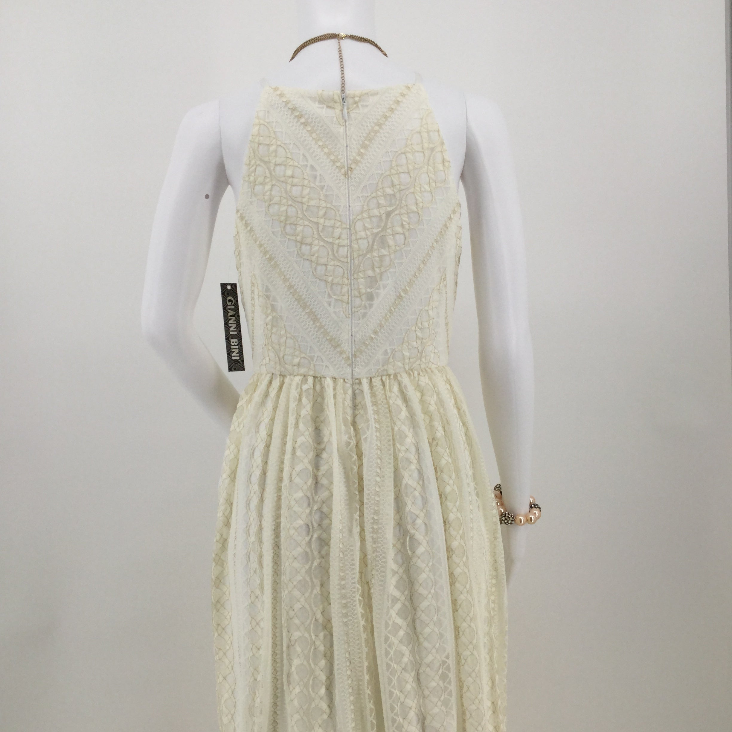 APPAREL,DRESSWEAR - SLEEVELESS, BOAT NECK DRESS IN CREAM COLORED LACE WITH GOLD ACCENTS. NEW WITH TAGS. 58
