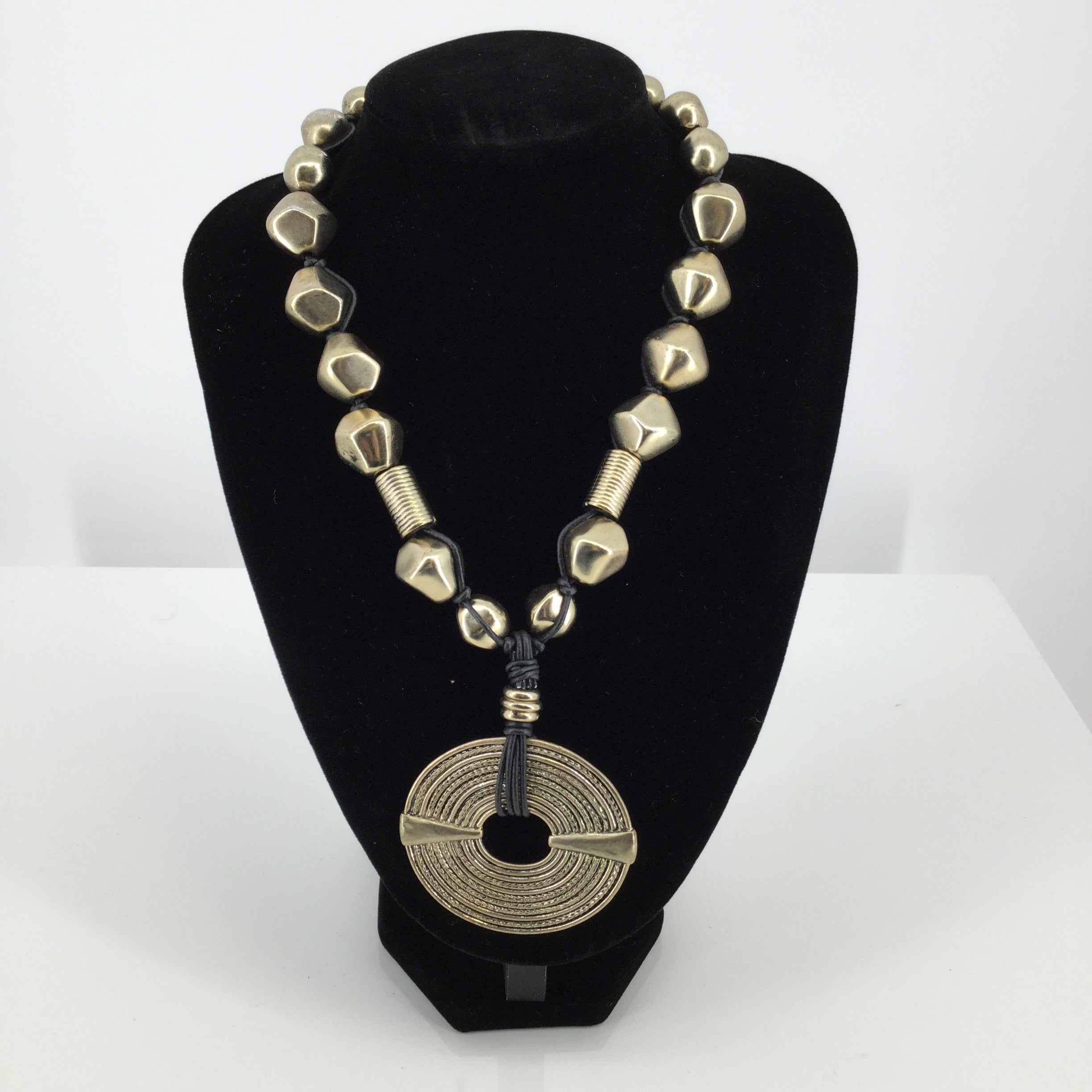 JEWELRY, - ADJUSTABLE GOLD AND LEATHER NECKLACE ACCENTED WITH A LARGE GOLD DISC. 18-20