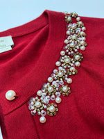Kate Spade Sweater Cardigan Lightweight Size:s - THIS GREAT KATE SPADE CARDIGAN ADDS THE RIGHT AMOUNT OF POP TO ANY OUTFIT! THE RED STANDS OUT WITH THE PEARLS AND BEADS GIVING IT AN ADDED TOUCH OF ELEGANCE. NEW WITH TAGS AND COMES WITH EXTRA BUTTONS.