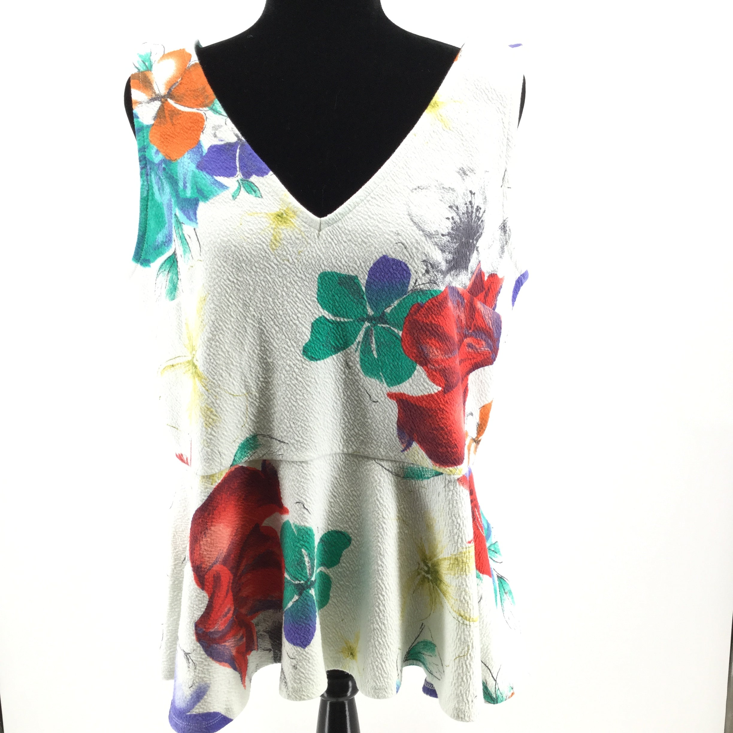 APPAREL,TOPS - SLEEVELESS TOP WITH RUFFLED BOTTOM AND TIE BACK. 70% COTTON. 28% POLYESTER. 2% SPANDEX. MACHINE WASH COLD.