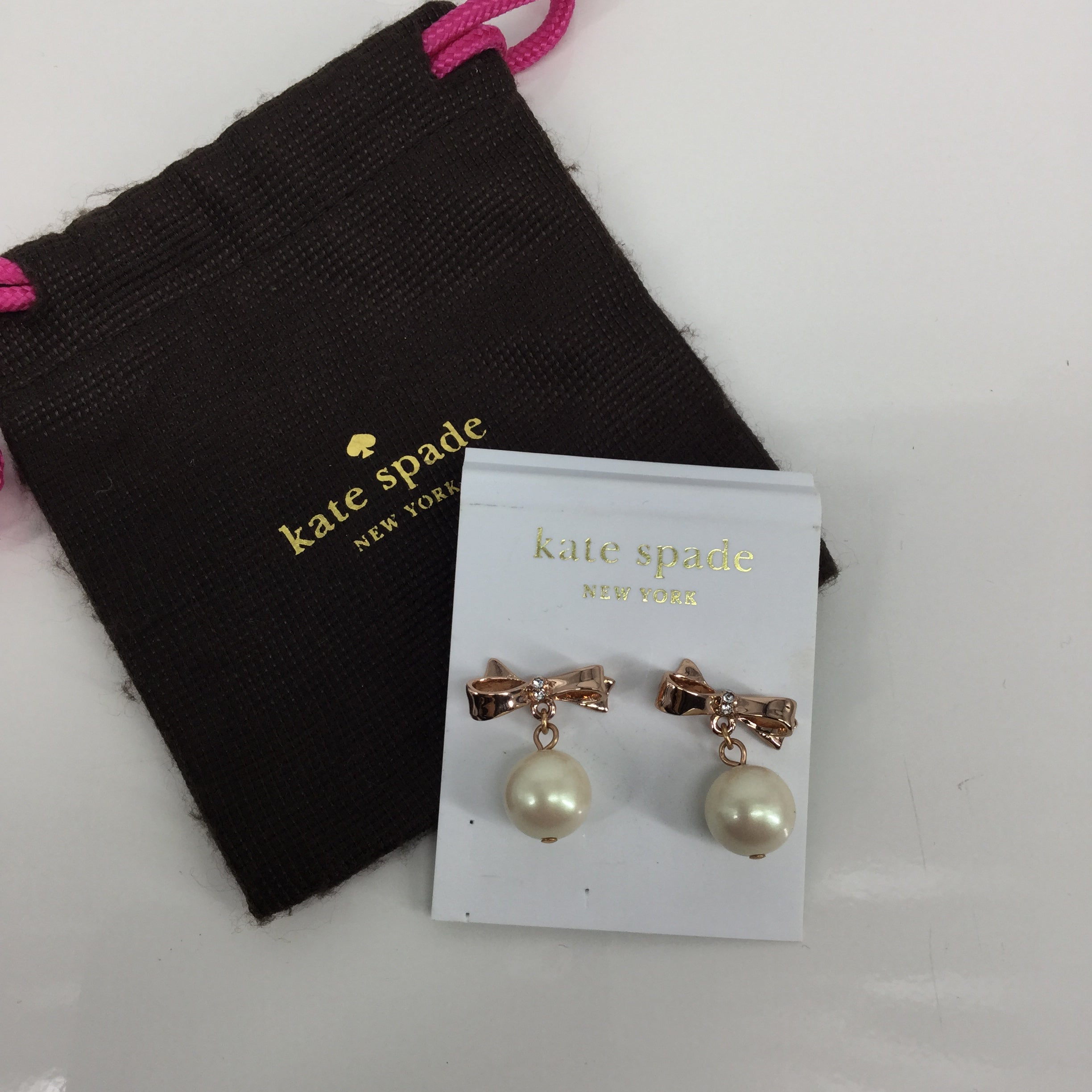 Kate Spade Earrings - GREAT FOR THE HOLIDAYS POST EARRING WITH CLEAR GEM IN MIDDLE OF A ROSE COLORED BOW AND A DANGLE PEARL!