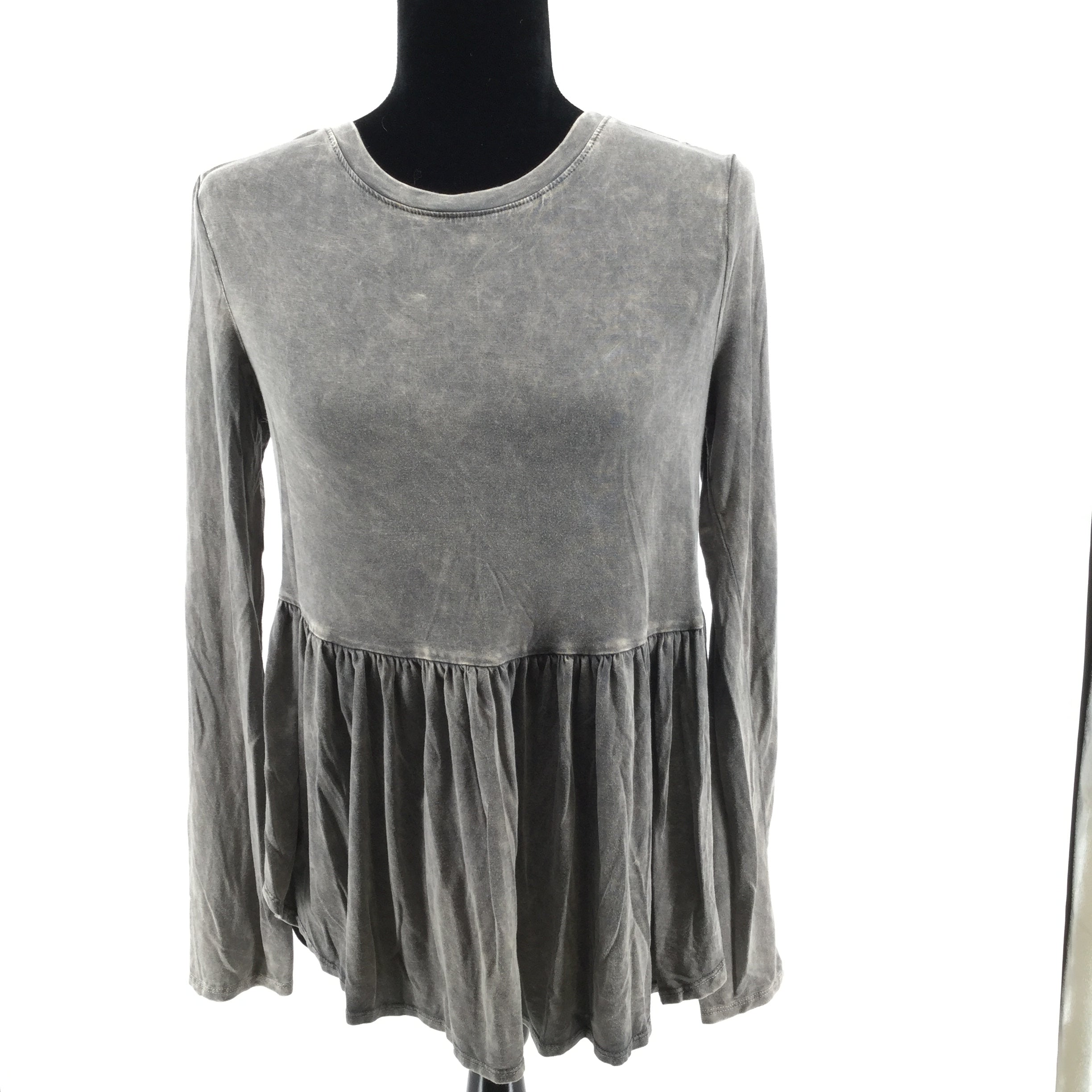 APPAREL,TOPS - LONG SLEEVE GARMENT DYED TOP WITH BOTTOM RUFFLE AND SLITS ON THE SIDES. GENEROUS FIT.