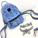 MCM Stark Side Studs Bebe Boo Backpack - BRAND NEW CONDITION MINI BACKPACK IN LIGHT BLUE VISETOS PRINT. DARK STEEL COLOR HARDWARE. PROTECTIVE WRAP STILL ON LOGO PLATE. FRONT ZIPPER POCKET, TWO SLIPS POCKET, ONE ONE SIDE. BLACK LINING WITH TWO CREDIT CARD SLIP POCKETS INSIDE. TWO REMOVABLE STRAPS. COMES WITH DUST BAG.