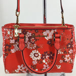 Michael By Michael Kors Handbag - KELLEN SATCHELBRIGHT ORANGE WITH FLORAL PATTERN. GOLD HARDWARE, 2 SHORT STRAPS, 1 ADJUSTABLE AND REMOVABLE CROSSBODY STRAP, 1 EXTERIOR ZIP POCKET, 1 EXTERIOR SNAP CLOSURE POCKET, 1 INTERIOR SLIP POCKETS, AND 1 INTERIOR ZIP POCKET.