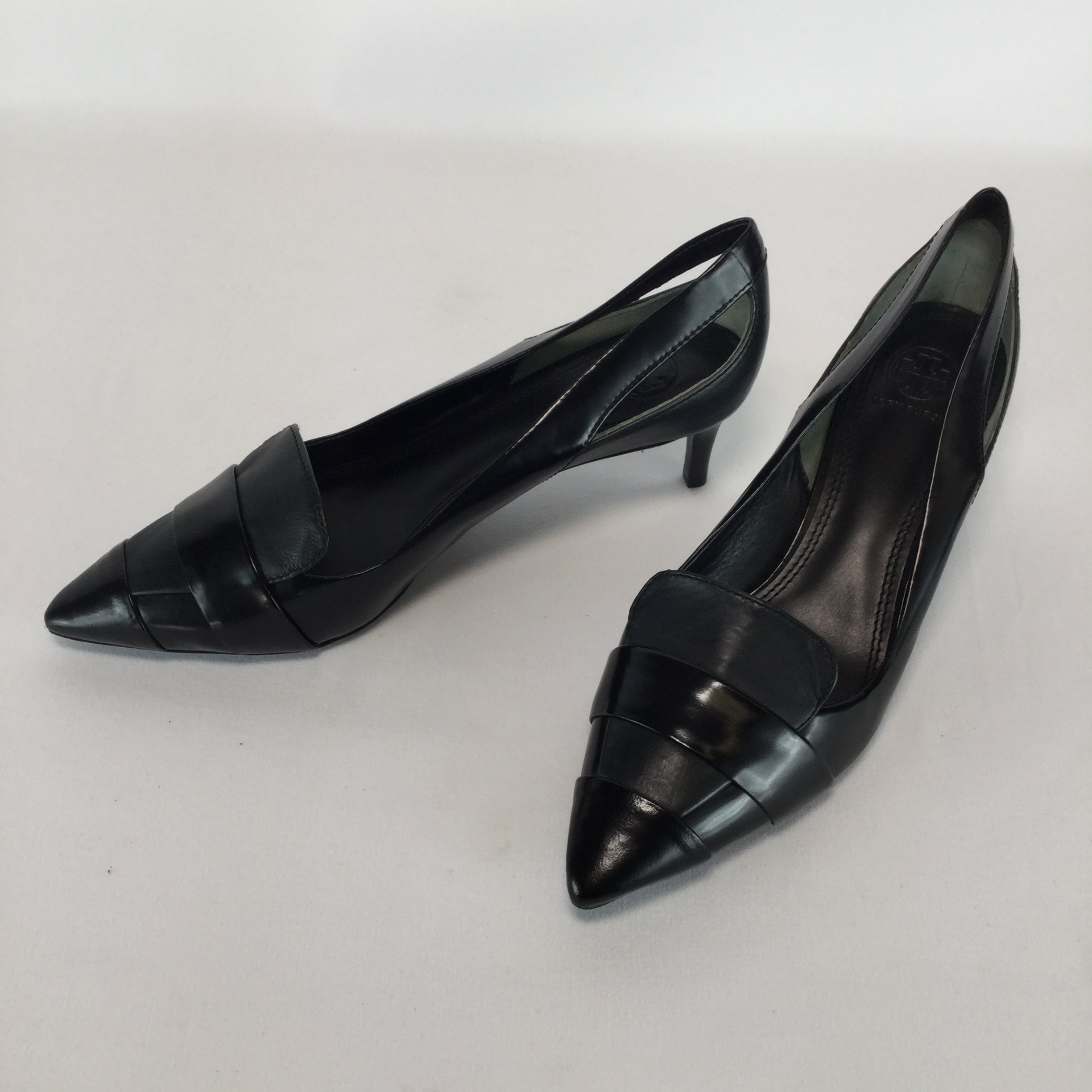 SHOES, - CLASSIC BLACK LEATHER LOW HEEL SHOE. PEEP CUT OUTS NEAR THE ANKLE.