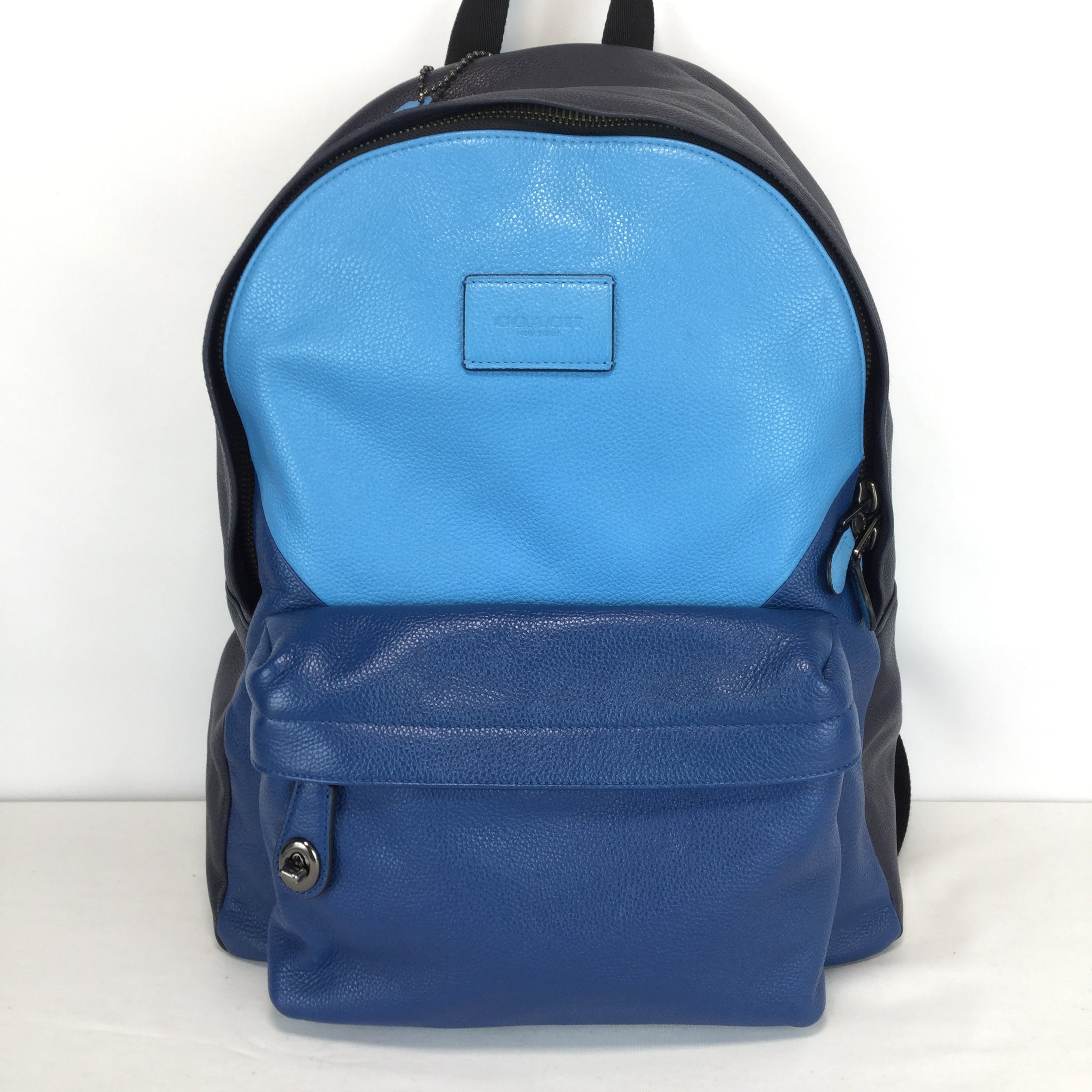 ACCESSORIES,PURSES AND HANDBAGS - THIS BACKPACK IS SO NICE IN A TRI-COLOR BLUE. LEATHER MATERIAL, ADJUSTABLE STRAPS, FRONT ZIPPED POCKET, 3 INSIDE SLIP POCKETS, AND 1 INSIDE ZIP POCKET.