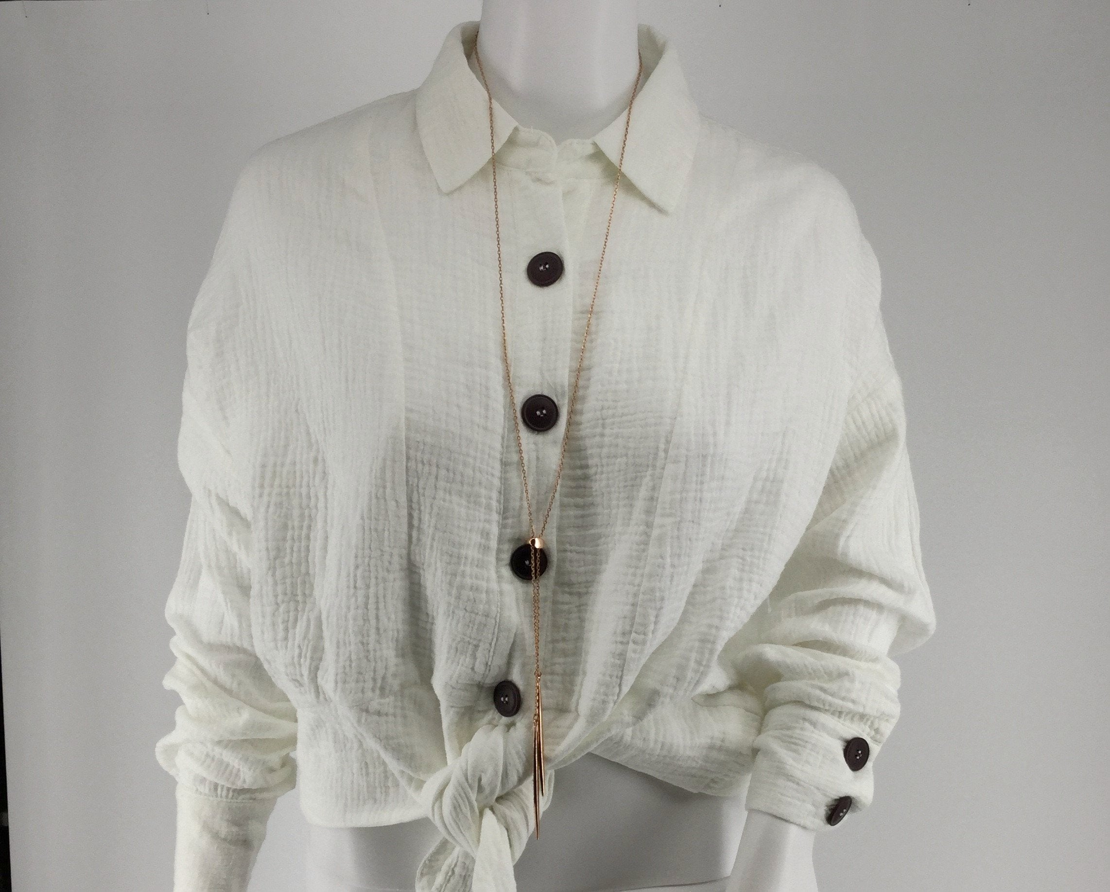 APPAREL,TOPS - FREE PEOPLE LONG SLEEVE TOP TEXTURED MATERIAL WITH A TIE DETAIL AT THE WAIST. BRIGHT WHITE TOP LENGTH WILL SIT AT THE WAIST.