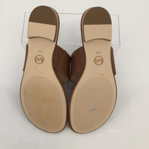 SHOES, - CARMEL COLORED SANDALS WITH TOE POST. GOLD MK EMBLEM. WOMENS SIZE 9.5. LEATHER UPPER. RUBBER OUTSOLE.