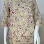 Ann Taylor Top ss Size:xs - ANN TAYLOR TEXTURED FLORAL SHORT SLEEVE TOP WITH PLEATED SLEEVE DETAILPINK AND PURPLE FLOWERS WITH DIAMOND TEXTURED DETAIL IN THE FABRICSIZE X-SMALL100% POLYESTERMACHINE WASHABLE